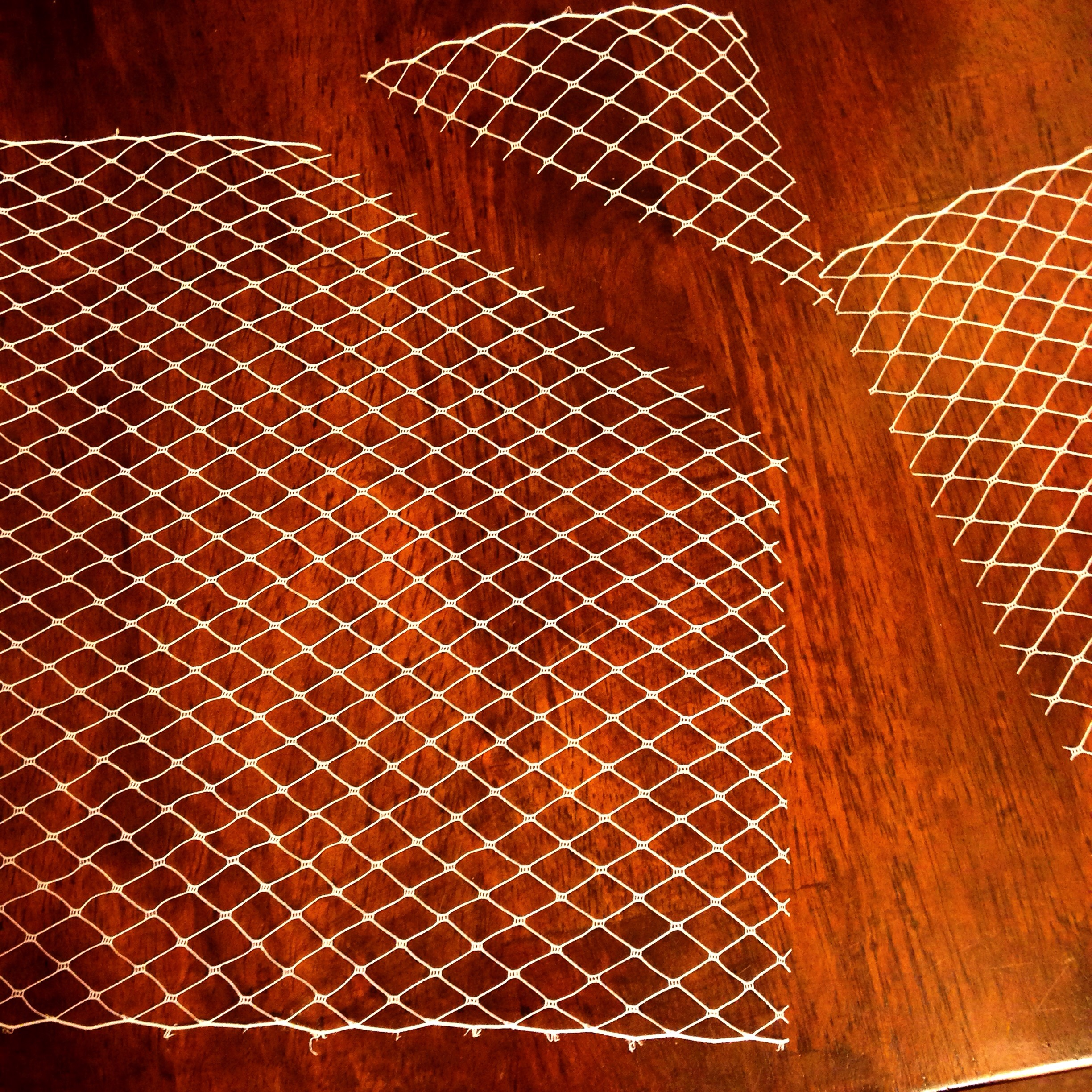 2490a0418c8b4 STEP 2  Count 7 holes down and follow the line of the netting to cut off  the upper right corner. Repeat for the other side.